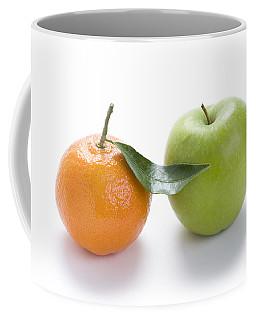 Coffee Mug featuring the photograph Fresh Apple And Orange On White by Lee Avison