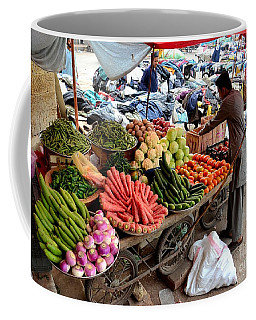 Fruit And Vegetable Seller Tends To His Cart Outside Empress Market Karachi Pakistan Coffee Mug