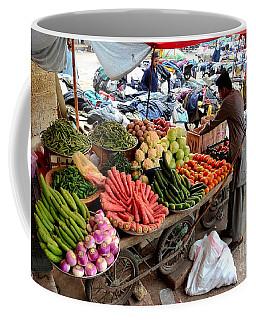 Fruit And Vegetable Seller Tends To His Cart Outside Empress Market Karachi Pakistan Coffee Mug