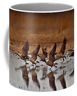 Coffee Mug featuring the photograph Geese On The Run by Lynn Hopwood