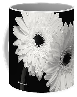 Coffee Mug featuring the photograph Gerbera Daisy Sisters by Jeannie Rhode