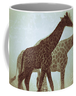 Coffee Mug featuring the photograph Giraffes In The Mist by Nick  Biemans