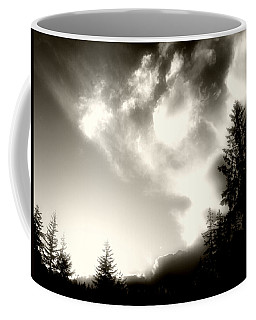 Coffee Mug featuring the photograph Glowing Clouds by Adria Trail