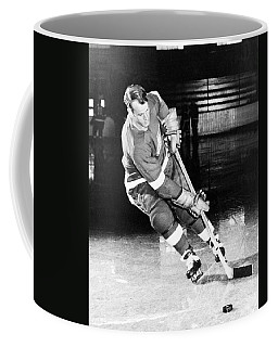 Gordie Howe Skating With The Puck Coffee Mug