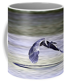 Coffee Mug featuring the photograph Great Blue Heron In Flight by John Haldane