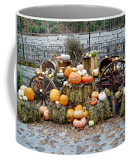 Coffee Mug featuring the photograph Halloween Pumpkins by Susan Leonard