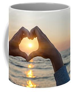 Heart Shaped Hands Framing Ocean Sunset Coffee Mug