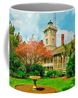Hereford Inlet Lighthouse Garden Coffee Mug by Nick Zelinsky
