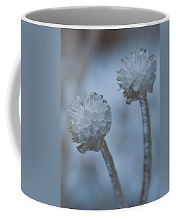 Coffee Mug featuring the photograph Ice-covered Winter Flowers With Blue Background by Cascade Colors