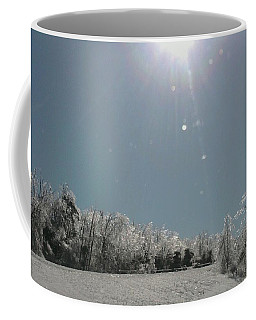 Coffee Mug featuring the photograph Ice Kissed by Ellen Levinson