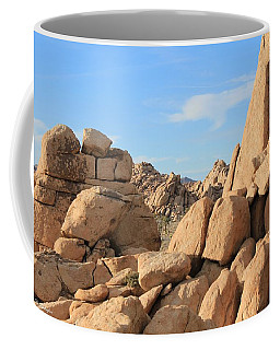 Coffee Mug featuring the photograph In Between The Rocks by Amy Gallagher