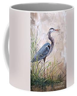 In The Reeds-blue Heron-a Coffee Mug