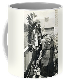 Coffee Mug featuring the photograph Indian Chief And Woman by Charles Beeler