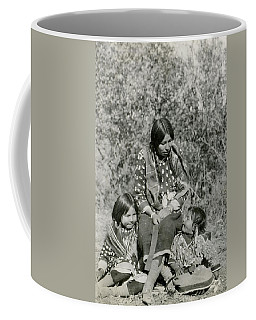 Coffee Mug featuring the photograph Indian Mother With Daughters by Charles Beeler