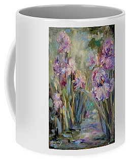 Coffee Mug featuring the painting Iris Garden by Mary Wolf