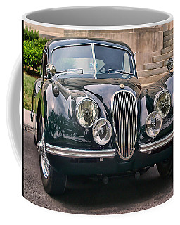 Coffee Mug featuring the photograph Jaguar by Victor Montgomery