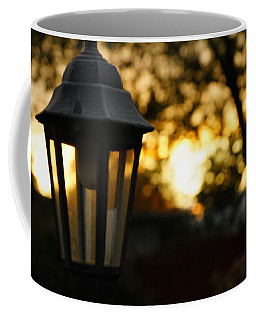 Coffee Mug featuring the photograph Lamplight by Photographic Arts And Design Studio