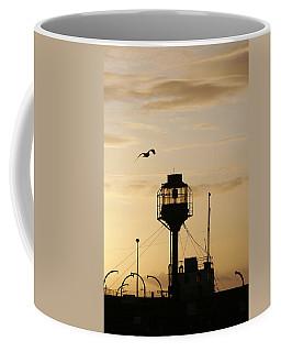 Light Ship Silhouette At Sunset Coffee Mug