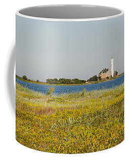 Lighthouse At Yellow Coast Coffee Mug