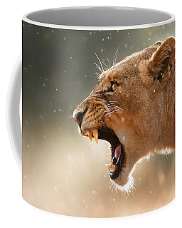Lioness Displaying Dangerous Teeth In A Rainstorm Coffee Mug