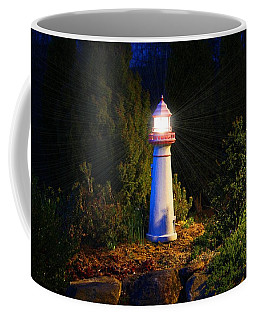 Lit-up Lighthouse Coffee Mug by Kathryn Meyer
