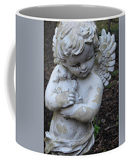 Coffee Mug featuring the photograph Little Angel by Beth Vincent