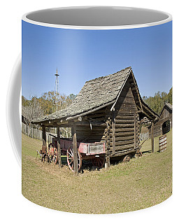 Coffee Mug featuring the photograph Log Cabin And Barn by Charles Beeler