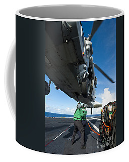 Logistics Specialists Hook Cargo Onto Coffee Mug