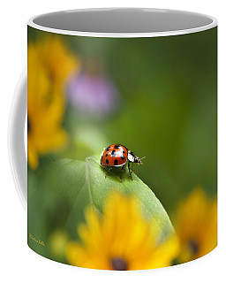 Coffee Mug featuring the photograph Lonely Ladybug by Christina Rollo