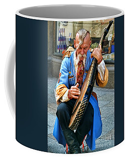 Coffee Mug featuring the photograph Making A Living by Mariola Bitner