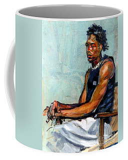 Male Figure Sitting Coffee Mug