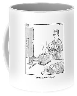 Man, Holding Dog, Speaks To Dog As Both Watch Coffee Mug
