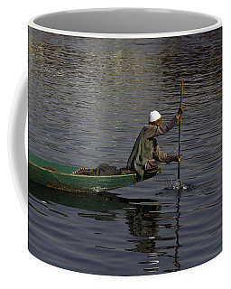 Man Plying A Wooden Boat On The Dal Lake Coffee Mug
