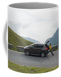 Man Rests On Trunk Of Car On Mountain Coffee Mug