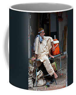 Man Sits And Relaxes In Lahore Walled City Pakistan Coffee Mug