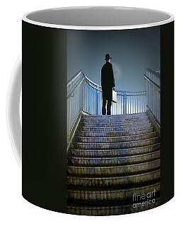 Coffee Mug featuring the photograph Man With Case At Night On Stairs by Lee Avison