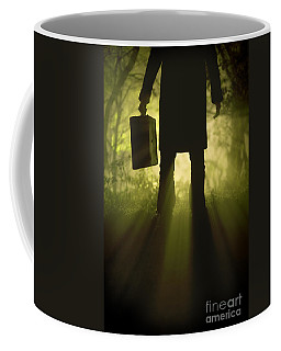 Coffee Mug featuring the photograph Man With Case In Fog by Lee Avison