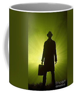 Coffee Mug featuring the photograph Man With Case In Green Light by Lee Avison
