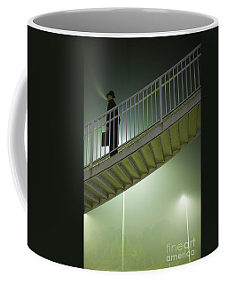 Coffee Mug featuring the photograph Man With Case On Steps Nighttime by Lee Avison