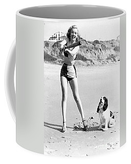 Marilyn Playing Baseball At The Beach Coffee Mug