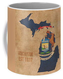 Michigan State Flag Map Outline With Founding Date On Worn Parchment Background Coffee Mug