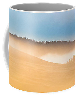 Coffee Mug featuring the photograph Misty Yellowstone   by Lars Lentz