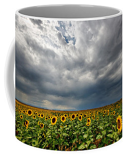 Moody Skies Over The Sunflower Fields Coffee Mug