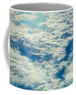 Coffee Mug featuring the photograph Mostly Cloudy by Mark Greenberg