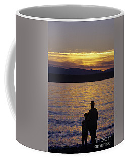 Mother And Daughter Holding Each Other Along Edmonds Beach At Su Coffee Mug