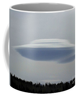 Coffee Mug featuring the photograph Mother Ship by Fiona Kennard