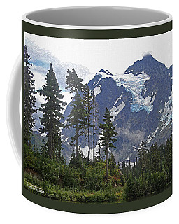 Mount Baker And Fir Trees And Glaciers And Fog Coffee Mug by Tom Janca