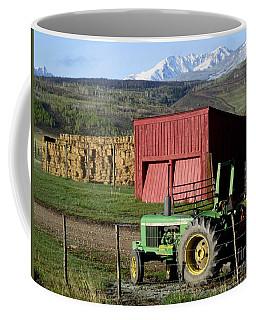 Coffee Mug featuring the photograph Mountain Living by Fiona Kennard