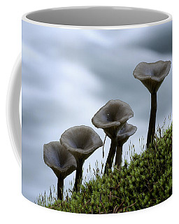 Coffee Mug featuring the photograph Mushrooms On Moss by Betty Depee