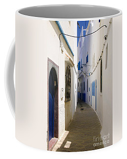 Coffee Mug featuring the photograph Narrow Backstreet In The Medina Of Asilah On Northwest Tip Of Atlantic Coast Of Morocco by Ralph A  Ledergerber-Photography